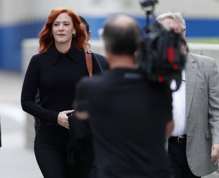 Tree Paine, publicist for pop singer Taylor Swift, arrives for the morning session of the the fourth day of a civil trial to determine whether a Denver radio host groped the singer in a case in federal court Thursday, Aug. 10, 2017, in Denver. Former DJ David Mueller sued Swift after she said he touched her backside before a concert in Denver in 2013. He's seeking at least $3 million. Swift countersued for sexual assault and is seeking $1.(AP Photo/David Zalubowski)