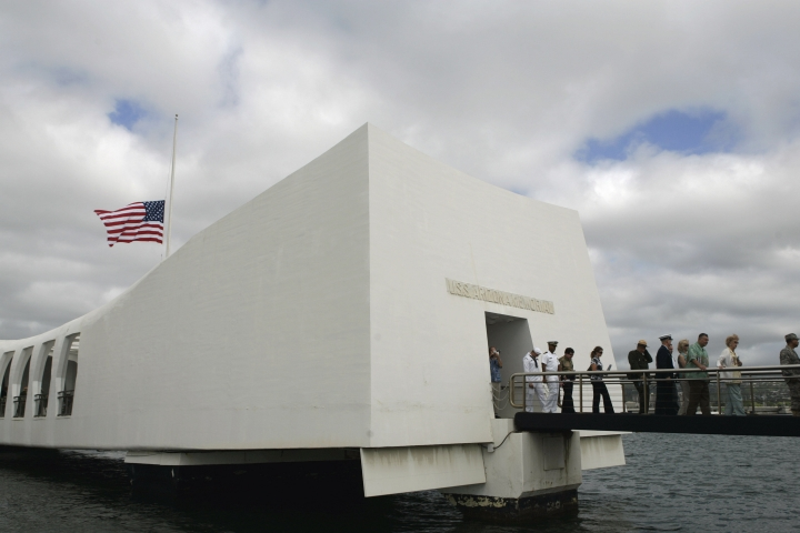 FILE - This Monday, Dec. 7, 2009 file photo shows the USS Arizona Memorial during the 68th anniversary ceremony of the attack on Pearl Harbor at Pearl Harbor Naval Base in Honolulu. Pacific Historic Parks, a nonprofit that supports National Park Service operations at Pearl Harbor said Thursday, Aug. 10, 2017 its CEO is no longer with the organization. (AP Photo/Marco Garcia, File)