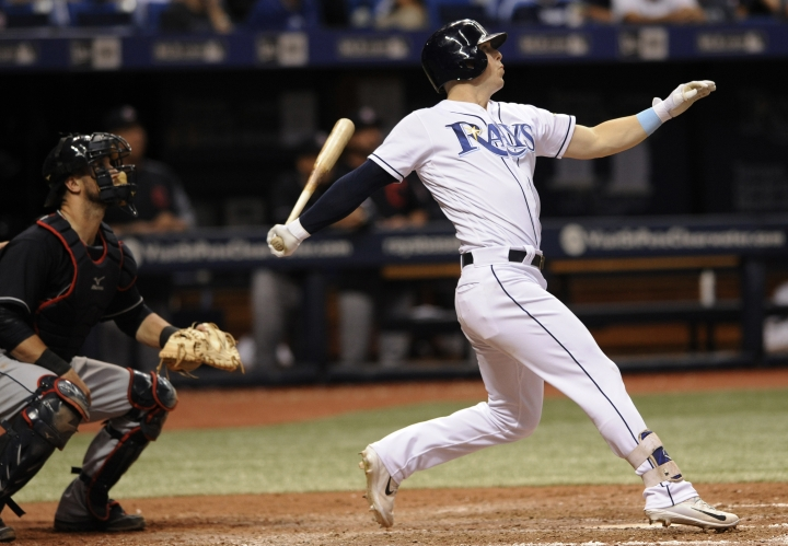 Tampa Bay Rays' Corey Dickerson watches his three-run home run off Indians reliever Nick Goody during the eighth inning of a baseball game Thursday, Aug. 10, 2017, in St. Petersburg, Fla. (AP Photo/Steve Nesius)