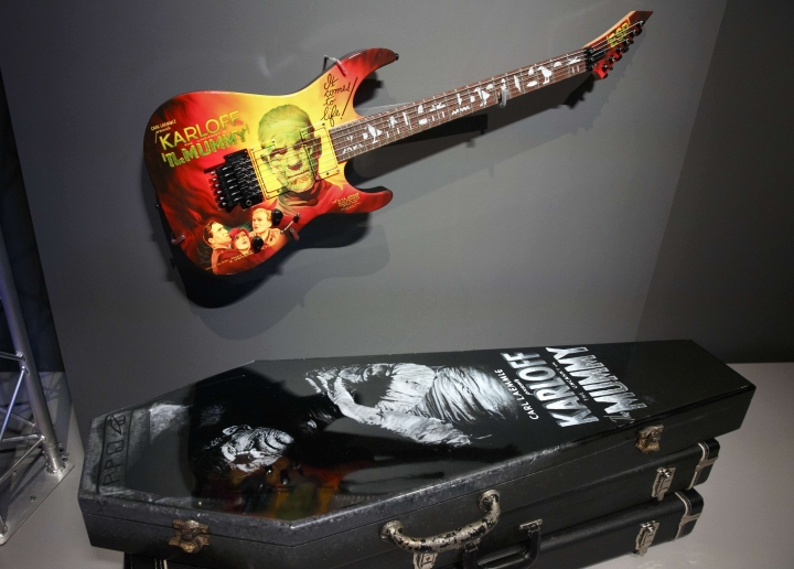 In this Wednesday, Aug. 9, 2017 photo, one of Metallica lead guitarist Kirk Hammett's guitars is seen on display at the Peabody Essex Museum in Salem, Mass. A new exhibition opening Saturday, Aug. 12 at the museum features 135 works from Metallica guitarist Hammett's collection of classic horror and sci-fi movie posters and memorabilia, including some he says have inspired his music. (AP Photo/Michael Dwyer)