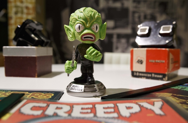 In this Wednesday, Aug. 9, 2017 photo, a toy Saucer-Man figurine is seen at the Peabody Essex Museum in Salem, Mass. A new exhibition opening Saturday, Aug. 12 at the museum features 135 works from Metallica guitarist Kirk Hammett's collection of classic horror and sci-fi movie posters and memorabilia, including some Hammett says have inspired his music. (AP Photo/Michael Dwyer)