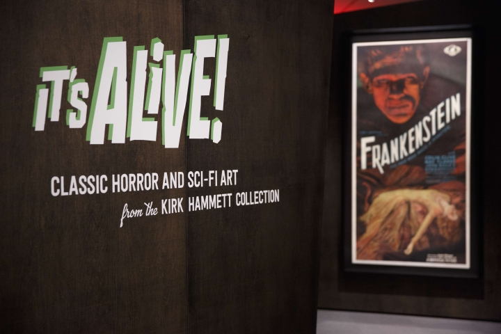 "In this Wednesday, Aug. 9, 2017 photo, a Frankenstein movie poster greets visitors to the ""It's Alive: Classic Horror and Sci-fi art from the Kirk Hammett Collection"" exhibit at the Peabody Essex Museum in Salem, Mass. The new exhibition opening Saturday, Aug. 12 at the museum features 135 works from Metallica guitarist Kirk Hammett's collection of classic horror and sci-fi movie posters and memorabilia, including some Hammett says have inspired his music. (AP Photo/Michael Dwyer)"
