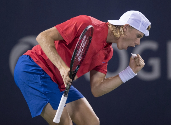 Denis Shapovalov, of Canada, celebrates winning a point over Rafael Nadal, of Spain, at the Rogers Cup tennis tournament Thursday, Aug. 10, 2017, in Montreal. (Paul Chiasson/The Canadian Press via AP)