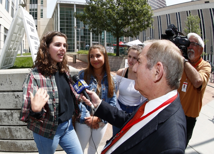 Grace Jarecke, from left, Dani Kuta and Lucy Peterson talk to a Denver television reporter about a civil trial involving former radio host David Mueller and pop singer Taylor Swift, Tuesday, Aug. 8, 2017, in Denver. (AP Photo/David Zalubowski)