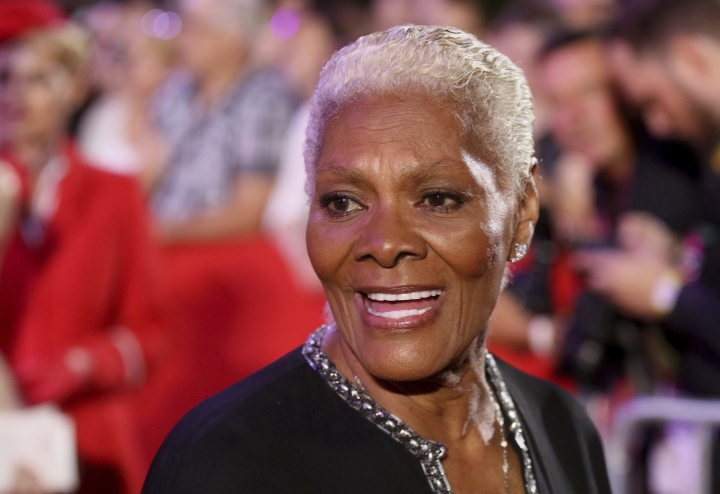 "FILE - In this June 10, 2017 file photo, singer Dionne Warwick arrives for the opening ceremony of the Life Ball in front of the City Hall in Vienna, Austria. Warwick will be honored with an award named for a pioneering opera singer. The Marian Anderson Award is given in Philadelphia to ""critically acclaimed artists who have impacted society in a positive way."" Anderson was the first black singer to perform at the Metropolitan Opera. Mayor Jim Kenney announced Thursday, Aug. 10, that the five-time Grammy winner will receive the award at a Nov. 14 ceremony.(AP Photo/Ronald Zak, File)"