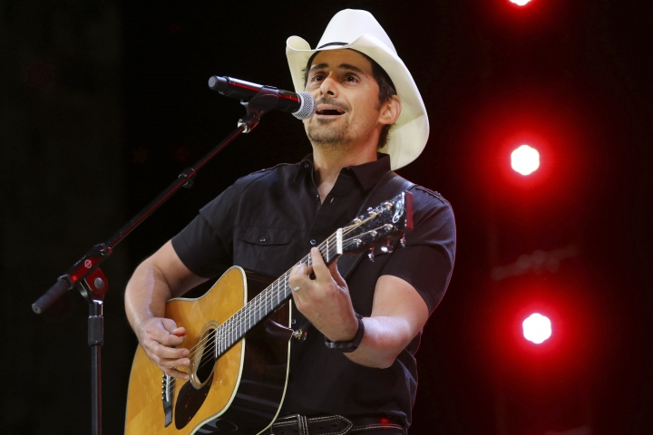 "FILE - In this June 2, 2017 file photo, Country music recording artist Brad Paisley performs at the graduation for Barrington High School, at Willow Creek Community Church in South Barrington, Ill. Paisley says years of hosting the Country Music Awards and writing songs with humorous lyrics have - hopefully - prepared him to host his first comedy special, the ""Brad Paisley Comedy Rodeo,"" which will premiere on Netflix on Tuesday, Aug. 15. (Steve Lundy /Daily Herald via AP, File)"
