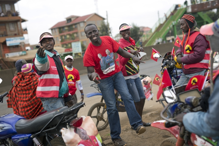 Supporters of President Uluru Kenyatta celebrate in anticipation of the announcement of the presidential election's final results Friday , Aug. 11, 2017. Several days after Kenyans voted in elections, the country on Friday was awaiting an announcement of official results that have become a source of bitter contention following opposition allegations of vote-rigging. While most of the country was calm, hundreds of riot police patrolled Nairobi's central business district and opposition supporters burned tires and blocked roads in several areas (AP Photo/Jerome Delay)