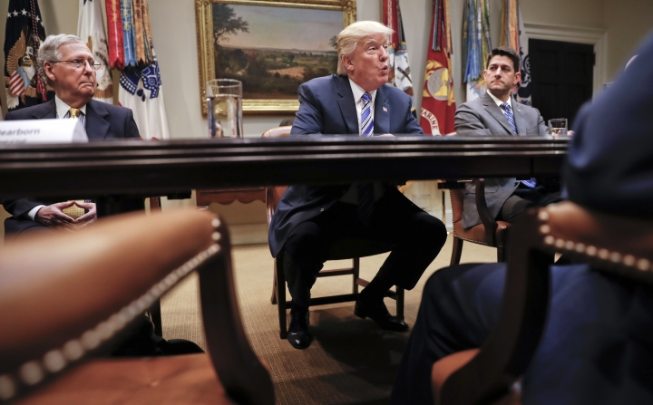 FILE - In this June 6, 2017 file photo, President Donald Trump, flanked by Senate Majority Leader Mitch McConnell of Ky., left, and House Speaker Paul Ryan of Wis., speaks in the Roosevelt Room of the White House in Washington. President Donald Trump resumed his taunts of his party's Senate leader, expressing disbelief that McConnell couldn't persuade a Republican majority to pass a health care bill. (AP Photo/Pablo Martinez Monsivais, File)
