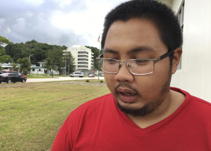 Jeremiah Lorenzo, 23, speaks to The Associated Press, in Hagatna, Guam on Friday, Aug. 11, 2017. Lifelong Guam resident Lorenzo, lives in Santa Rita, a village next to the naval base. He works at the University of Guam. (AP Photo/Tassanee Vejpongsa)