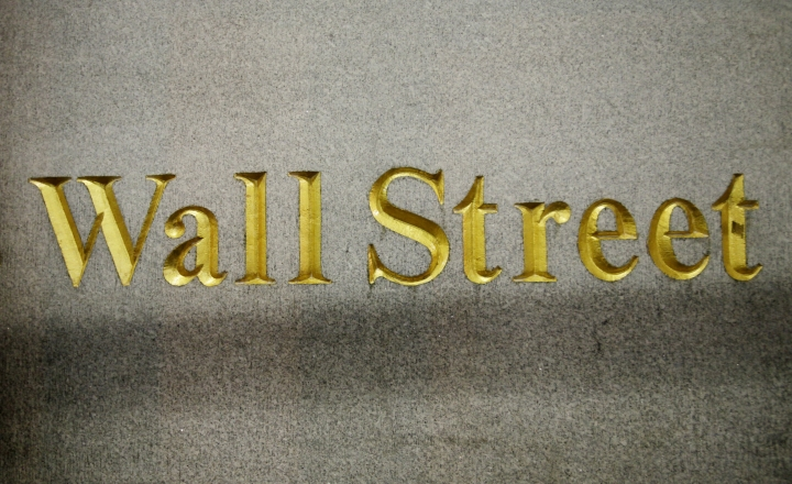 FILE - In this Oct. 8, 2014, file photo, a Wall Street address is carved in the side of a building in New York. Stocks are opening modestly higher on Wall Street, Friday, Aug. 11, 2017, led by gains in technology companies and banks. (AP Photo/Mark Lennihan, File)