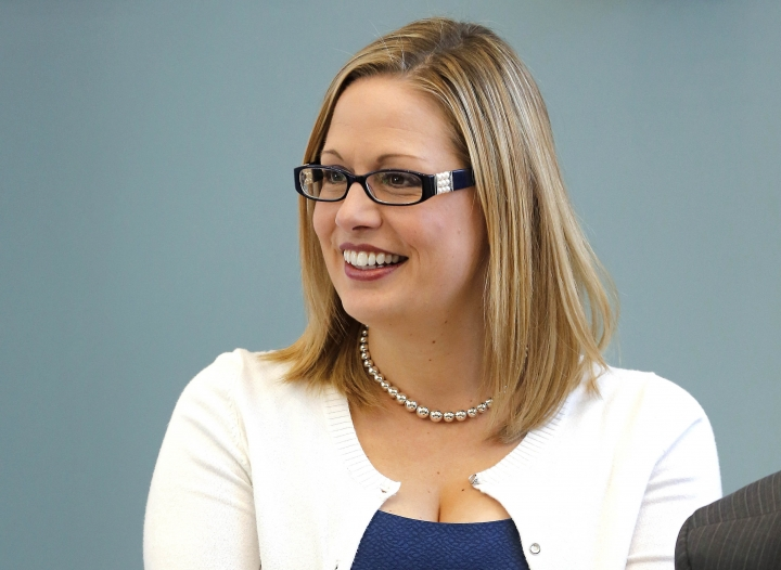 "FILE - In this Aug. 20, 2013 file photo, Rep. Kyrsten Sinema, D-Ariz. is seen in Tempe, Ariz. Sinema says she is ""seriously considering"" a run for the Arizona Senate seat occupied by Republican Jeff Flake. (AP Photo/Matt York, File)"