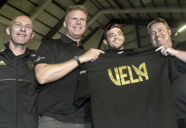 From left to right, Los Angeles FC head coach Bob Bradley, actor Will Ferrell, Los Angeles FC designated player Carlos Vela and LAFC lead managing owner Larry Berg pose at an MLS soccer news conference in Los Angeles, Friday, Aug. 11, 2017. (Walt Mancini/Los Angeles Daily News via AP)