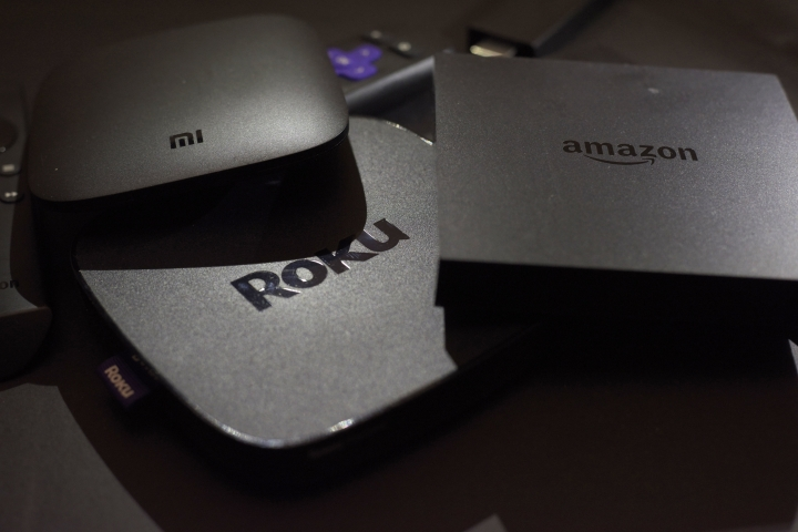 FILE - This Wednesday, Nov. 16, 2016, file photo shows Xiaomi's Mi Box, left, the Roku Premiere, center, and the Amazon Fire TV streaming TV devices in New York. The future of TV may well be a mishmash of streaming services that could wind up costing pretty close to a $100 cable bundle, but that are way too difficult to use. (AP Photo/File)
