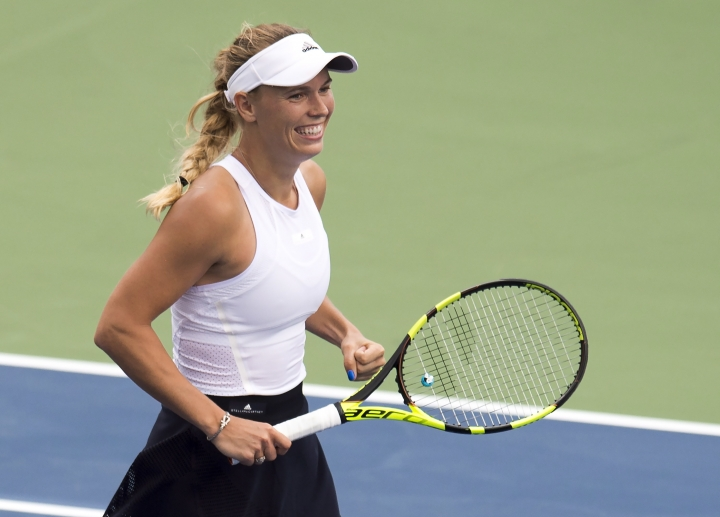 Caroline Wozniacki, of Denmark, smiles after defeating Karolina Pliskova, of the Czech Republic, in the quarterfinals of the Rogers Cup tennis tournament in Toronto on Friday, Aug. 11, 2017. (Frank Gunn/The Canadian Press via AP)