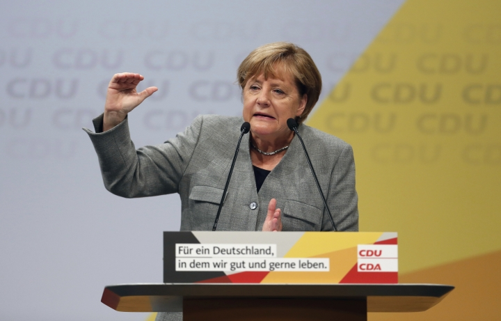 German Chancellor and top candidate of the Christian Democratic Union, CDU, for the upcoming general election Angela Merkel delivers a speech during the start of her election campaign in Dortmund, western Germany, Saturday, Aug. 12, 2017. (Ina Fassbender/dpa via AP)