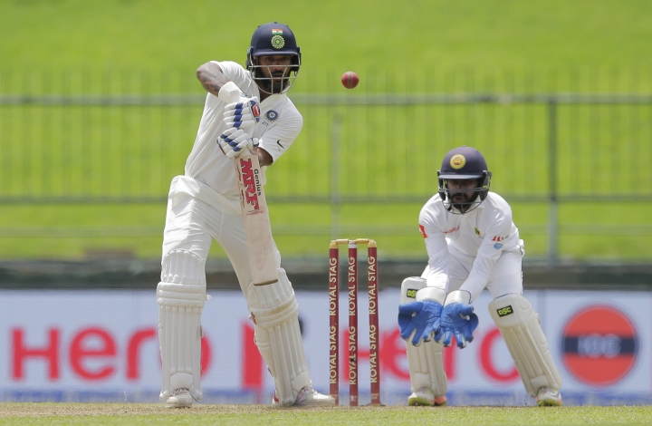 India's Shikhar Dhawan, left, plays a shot during the first day's play of their third cricket test match against Sri Lanka in Pallekele, Sri Lanka, Saturday, Aug. 12, 2017. (AP Photo/Eranga Jayawardena)