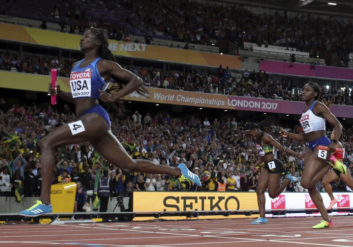 United States' Tori Bowie crosses the line to win the gold in the women's 4x100-meter relay final during the World Athletics Championships in London Saturday, Aug. 12, 2017. (AP Photo/Matthias Schrader)