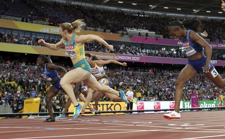 Australia's Sally Pearson crosses the line to win the gold in the women's 100-meter hurdles final during the World Athletics Championships in London Saturday, Aug. 12, 2017. (AP Photo/Matthias Schrader)