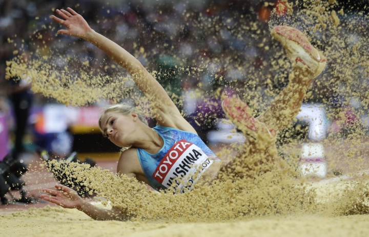 Russia's Darya Klishina makes an attempt in the women's long jump final during the World Athletics Championships in London Friday, Aug. 11, 2017. (AP Photo/Matthias Schrader)
