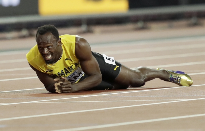 Jamaica's Usain Bolt lies on the track after he injured himself during the 4x100 m relay final during the World Athletics Championships in London Saturday, Aug. 12, 2017. (AP Photo/Tim Ireland)