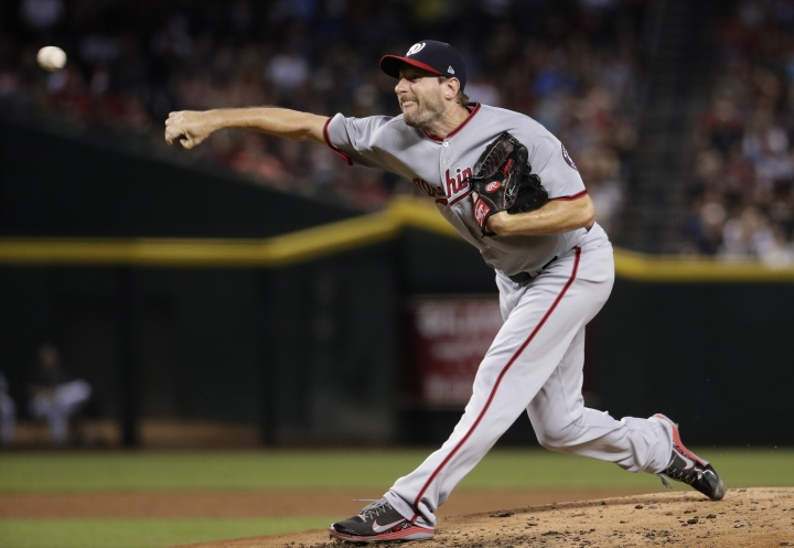 FILE - in this July 21, 2017, file photo, Washington Nationals starting pitcher Max Scherzer throws to the Arizona Diamondbacks during the first inning of a baseball game in Phoenix. Scherzer will start the second game of the Nationals' day-night doubleheader against the San Francisco Giants on Sunday, Aug. 13, well, because he feels like it. Manager Dusty Baker said Scherzer preferred to pitch at night. (AP Photo/Matt York, File)