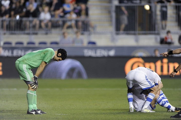 Philadelphia Union goalie John McCarthy, left, reacts after he was called for a penalty during the second half of an MLS soccer match against the Montreal Impact Saturday, Aug. 12, 2017, in Chester, Pa. The Impact won 3-0. (AP Photo/Michael Perez)