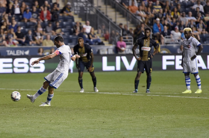 Montreal Impact's Ignacio Piatto kicks a penalty shot and scores during the second half of an MLS soccer match against the Philadelphia Union on Saturday, Aug. 12, 2017, in Chester, Pa. The Impact won 3-0. (AP Photo/Michael Perez)