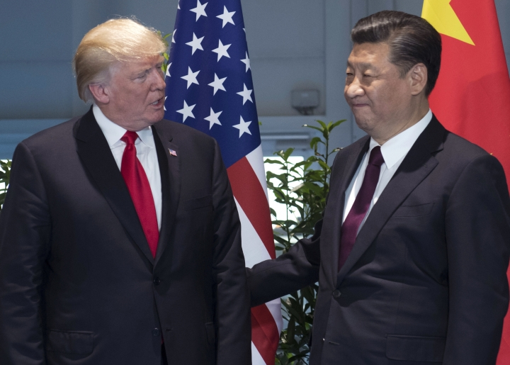 FILE - In this July 8, 2017, file photo, U.S. President Donald Trump, left, and China's President Xi Jinping arrive for a meeting on the sidelines of the G-20 Summit in Hamburg, Germany. Trump is planning to sign an executive action asking the U.S. Trade Representative to consider investigating China for the theft of U.S. technology and intellectual property. He is taking the step even as he seeks China's help with the ongoing crisis with North Korea. (Saul Loeb/Pool Photo via AP, File)