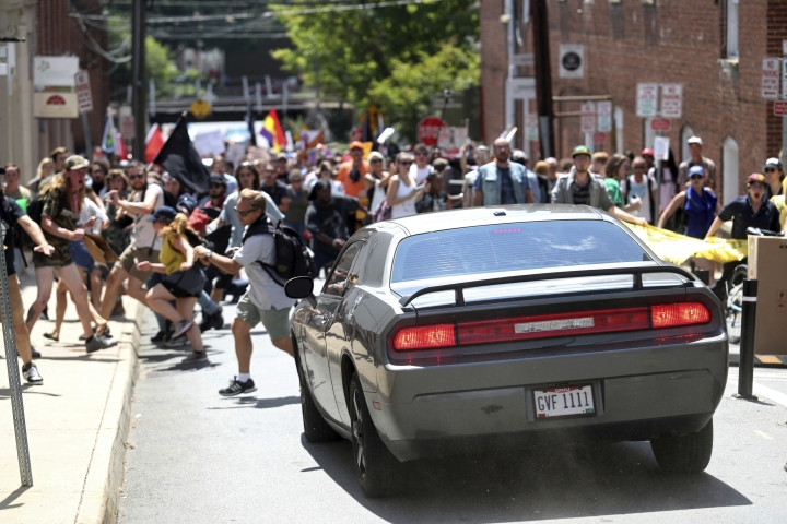 A vehicle drives into a group of protesters demonstrating against a white nationalist rally in Charlottesville, Va., Saturday, Aug. 12, 2017. The nationalists were holding the rally to protest plans by the city of Charlottesville to remove a statue of Confederate Gen. Robert E. Lee. There were several hundred protesters marching in a long line when the car drove into a group of them. /The Daily Progress via AP)