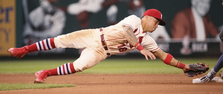 St. Louis Cardinals second baseman Kolten Wong dives toward second to try to tag Atlanta Braves' Freddie Freeman on a double by Freeman during the fifth inning of a baseball game Saturday, Aug. 12, 2017, at Busch Stadium in St. Louis. (Chris Lee/St. Louis Post-Dispatch via AP)