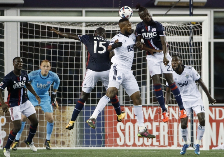 Vancouver Whitecaps' Kendall Waston, center, battles to get a head on the ball against New England Revolution's JeVaughn Watson (15) and Kei Kamara (23) during the second half of an MLS soccer game, Saturday, Aug. 12, 2017, in Foxborough, Mass. (AP Photo/Michael Dwyer)