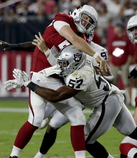 Arizona Cardinals quarterback Drew Stanton (5) is hit by Oakland Raiders middle linebacker Cory James (57) during the first half of an NFL preseason football game, Saturday, Aug. 12, 2017, in Glendale, Ariz. (AP Photo/Rick Scuteri)