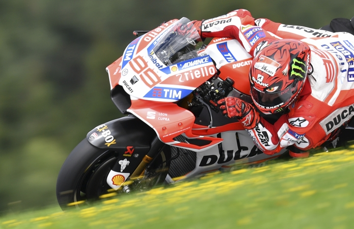 Spain's MotoGP rider Jorge Lorenzo of the Ducati Team rides during a warm up session for the MotoGP race at the Austrian motorcycle Grand Prix at the Red Bull Ring in Spielberg, Austria, Sunday, Aug. 13, 2017. (AP Photo/Kerstin Joensson)