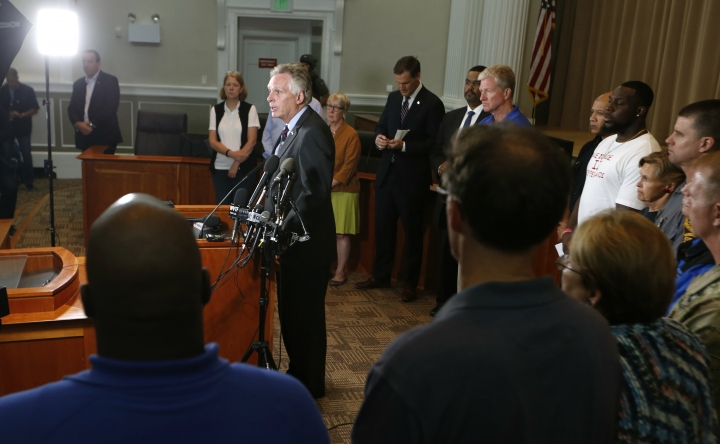 Virginia Gov. Terry McAuliffe addresses a news conference concerning the white nationalist rally and violence in Charlottesville, Va., Saturday, Aug. 12, 2017. (AP Photo/Steve Helber)