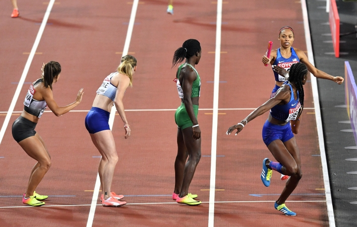 United States' Allyson Felix, top right, hands the baton to teammate Shakima Wimbley during the Women's 4x400 meters relay final at the World Athletics Championships in London Sunday, Aug. 13, 2017. (AP Photo/Martin Meissner)