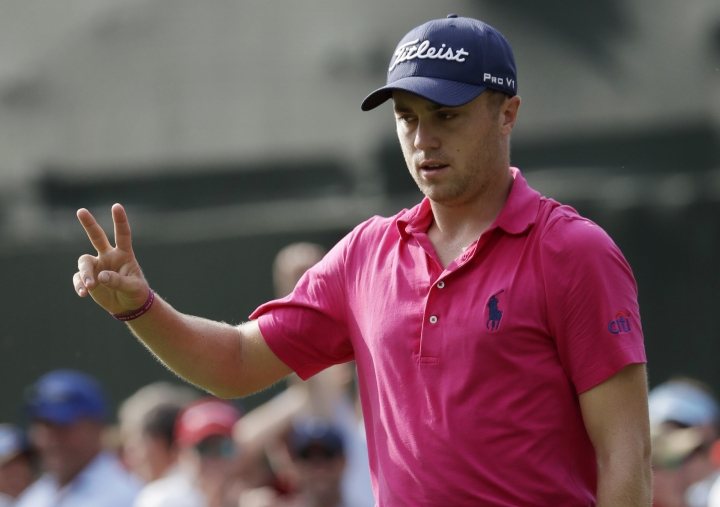 Justin Thomas celebrates after a birdie on the 13th hole during the final round of the PGA Championship golf tournament at the Quail Hollow Club Sunday, Aug. 13, 2017, in Charlotte, N.C. (AP Photo/John Bazemore)