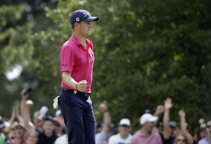 Justin Thomas celebrates after a birdie on the ninth hole during the final round of the PGA Championship golf tournament at the Quail Hollow Club Sunday, Aug. 13, 2017, in Charlotte, N.C. (AP Photo/Chris O'Meara)