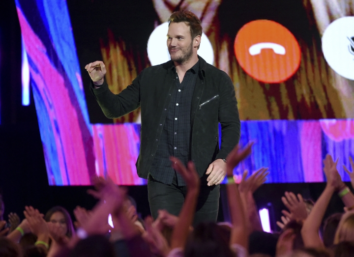 "Chris Pratt greets the audience as he accepts the award for choice sci-fi movie actor for ""Guardians of the Galaxy Vol. 2"" at the Teen Choice Awards at the Galen Center on Sunday, Aug. 13, 2017, in Los Angeles. (Photo by Phil McCarten/Invision/AP)"
