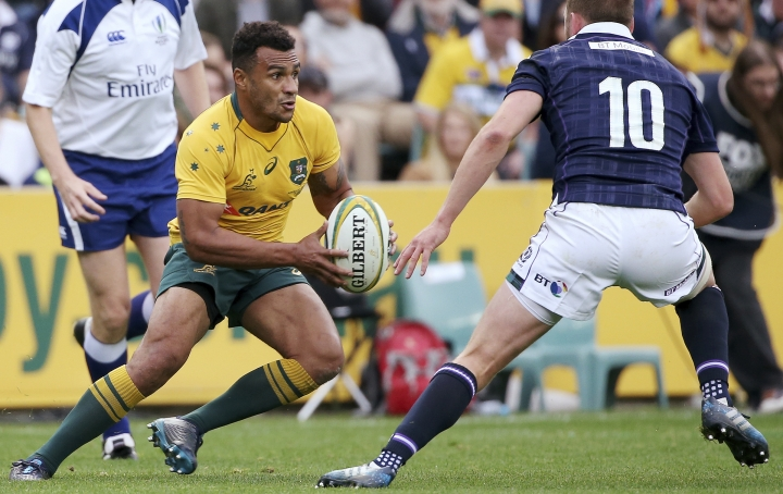 In this photo from June 17, 2017, Australia's Will Genia, left, sidesteps Scotland's Finn Russell during their rugby union test match in Sydney. Wallabies scrumhalf Genia has signed a two-year deal to join the Melbourne Rebels in the Super Rugby competition. (AP Photo/Rick Rycroft)