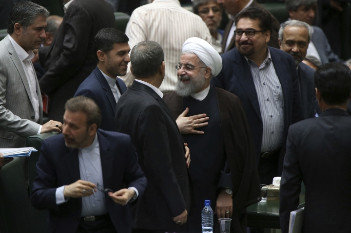 Iranian President Hassan Rouhani, center, leaves the parliament after his speech in a session to debate his proposed cabinet, in Tehran, Iran, Tuesday, Aug. 15, 2017. Iran's president issued a direct threat to the West on Tuesday, claiming his country is capable of restarting its nuclear program within hours — and quickly bringing it to even more advanced levels than in 2015, when Iran signed the nuclear deal with world powers. (AP Photo/Vahid Salemi)