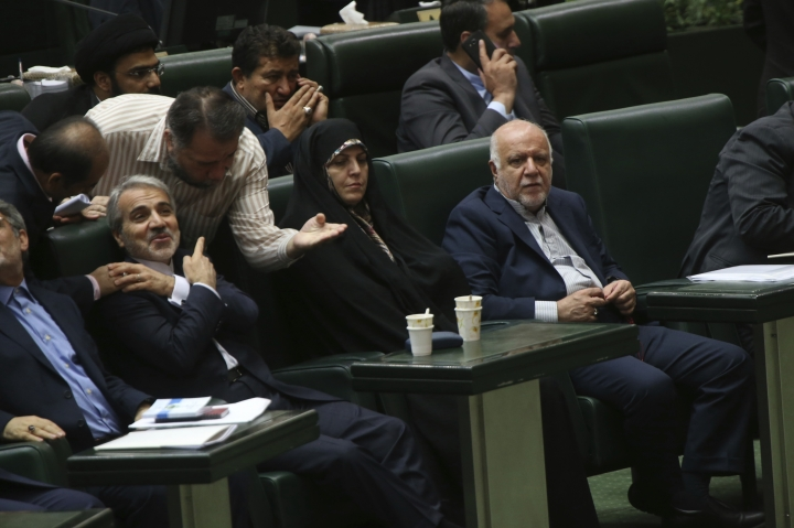 Iranian Oil Minister Bijan Zanganeh, right, who has been nominated for President Hassan Rouhani's new cabinet, sits in a session of parliament to debate proposed cabinet, in Tehran, Iran, Tuesday, Aug. 15, 2017. (AP Photo/Vahid Salemi)