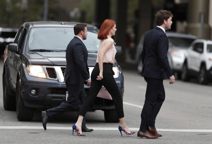 Tree Paine, center, publicist for pop singer Taylor Swift, follows the singer's brother, Austin, back to a hotel at the end of the civil trial involving the pop singer in a case in federal court Monday, Aug. 14, 2017, in Denver. (AP Photo/David Zalubowski)