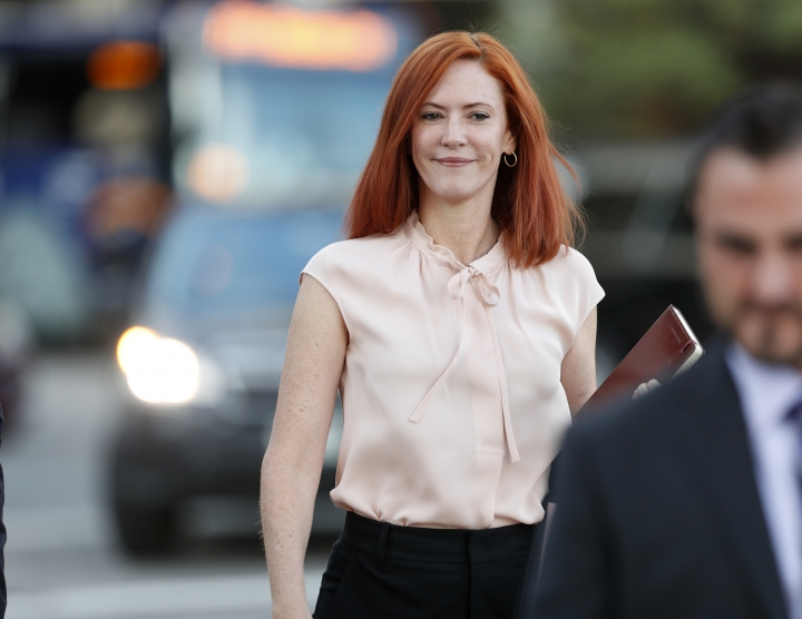 Tree Paine, publicist for pop singer Taylor Swift, heads to federal courthouse for the civil trial involving the pop singer in a case in federal court Monday, Aug. 14, 2017, in Denver. While the judge has cleared the pop singer, her mother, Andrea, and the singer's radio liaison are still facing allegations that they set out to have a radio host fired for allegedly groping Swift at a photo op before a concert in Denver in 2013. The eight-person jury is expected to decide on that case as well as consider the assault allegation leveled by the singer. (AP Photo/David Zalubowski)