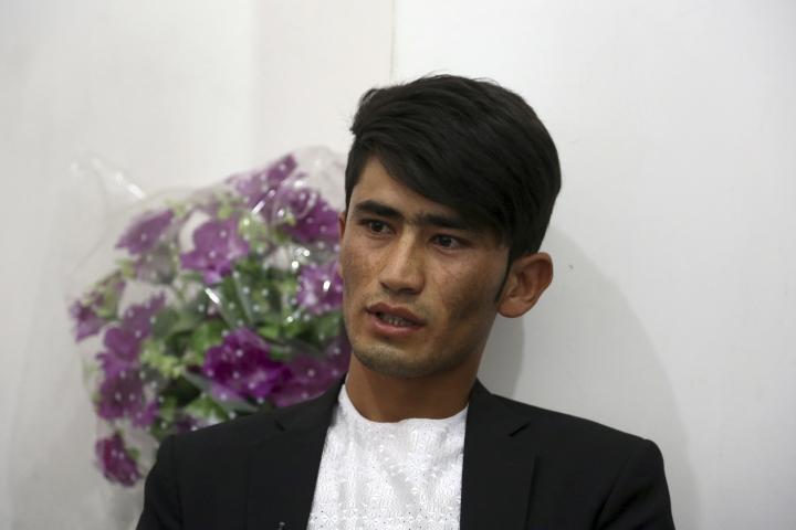 In this Thursday, Aug. 3, 2017 photo, Khadim Hossaini, whose sister, Najiba, was killed in a suicide attack last month, speaks during an interview with The Associated Press in Kabul, Afghanistan. Despite 16 years of war and billions of dollars in international aid, security is worsening and jobs have grown scarce. Khadim studied computer science and earned a degree, but these days Hossaini is searching for work. (AP Photo/Rahmat Gul)