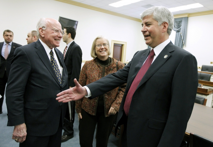 FILE - In this Dec. 1, 2010 file photo, Michigan Gov.-elect Rick Snyder, right, meets with members of the Michigan Congressional delegation, including Rep. Vern Ehlers, R-Mich., left, on Capitol Hill in Washington. Ehlers, a research physicist who served 17 years representing a western Michigan congressional district, has died. at 83. Melissa Morrison, funeral director at Zaagman Memorial Chapel, said Wednesday, Aug. 16, 2017, that Ehlers died late Tuesday at a Grand Rapids nursing facility. (AP Photo/Manuel Balce Ceneta File)