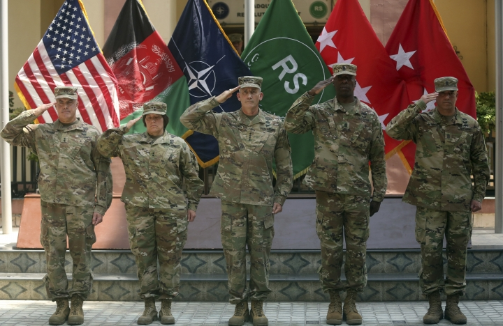 "FILE - In this Saturday, July 15, 2017 file photo, Army Gen. John W. Nicholson, center, commander of the Resolute Support mission and U.S. forces in Afghanistan; outgoing Maj. Gen. Richard G. Kaiser, left, and incoming Maj. Gen. Robin L. Fontes, second left, salute during a change of command ceremony at Resolute Support headquarters, in Kabul, Afghanistan. In an ""open letter"" to U.S. President Donald Trump, Afghanistan's Taliban on Tuesday reiterated their call for a withdrawal of troops to end the protracted war. (AP Photos/Massoud Hossaini)"