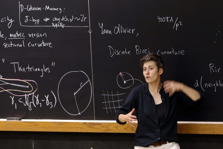 In this Monday, Aug. 7, 2017 photo, mathematics professor Moon Duchin speaks to attendees during a conference at Tufts University in Medford, Mass. Lawsuits challenging voting districts have risen since a 2013 Supreme Court case made it easier to draw new districts. Duchin realized her geometry research could be used to fight gerrymandering by figuring out if new voting districts pass legal muster. She's now started a summer program to teach mathematicians how to testify in court to help illuminate the complicated topic. (AP Photo/Bill Sikes)