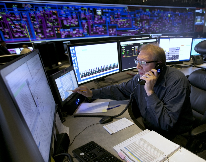 In this Thursday, Aug. 7, 2017 photo, Shift Supervisor Gary Anderson, monitors the power system flow and conditions at the Pacific Gas & Electric grid control center, in Vacaville, Calif. Power grid managers say they've been preparing extensively for more than a year for this Monday's solar eclipse and that by ramping up other sources of power, mainly hydroelectric and natural gas, they are confident nobody will lose power or see a spike in energy prices. (AP Photo/Rich Pedroncelli)