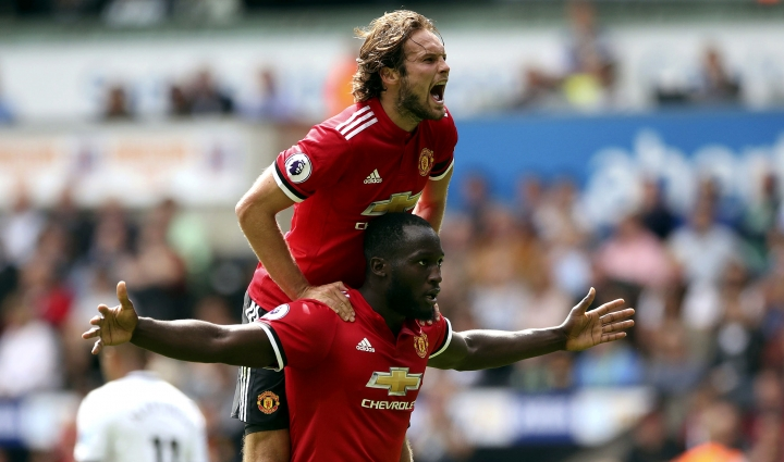 Manchester United's Romelu Lukaku, centre, celebrates scoring his side's second goal with team-mate Daley Blind during the English Premier League soccer match between Swansea and Manchester United, at the Liberty Stadium, in Swansea, Wales, Saturday Aug. 19, 2017. (Nick Potts/ PA via AP)