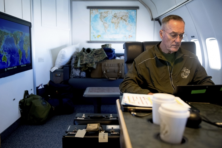Joint Chiefs Chairman Gen. Joseph Dunford works in his private cabin aboard his plane, Saturday, Aug. 19, 2017, while traveling to Andrews Air Force Base, Md. (AP Photo/Andrew Harnik)